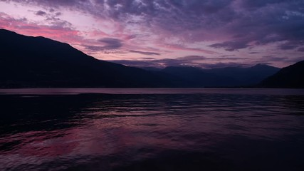 Wall Mural - Scenic Summer Sunset at the Lake Como in Northern Italy. Lombardy Region. Time Lapse Video.