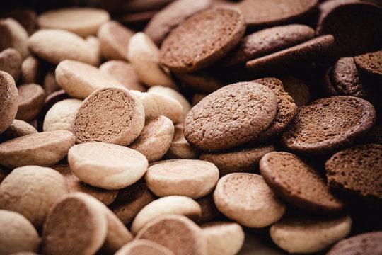 """Close up of cocoa and honey cookies, """"Broas de Coco"""" and """"Broas de Mel"""", traditional dessert of Madeira island, Portugal"""