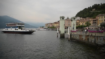 Wall Mural - August 20, 2019 City of Bellagio in Lombardy, Northern Region of the Italy. Ferry with Cars and Tourist and Bellagio Marina.