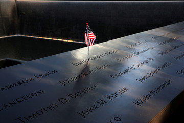 American flag at north reflecting pool during ceremonies commemorating the 18th anniversary of the September 11, 2001 attacks at the 911 Memorial in lower Manhattan in New York