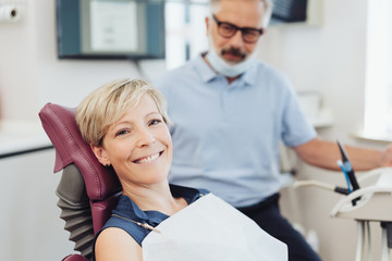 Smiling happy woman in a dental surgery