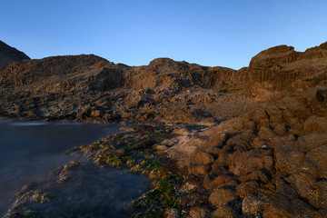 Lava flows with columnar jointing structures at Punta Baja