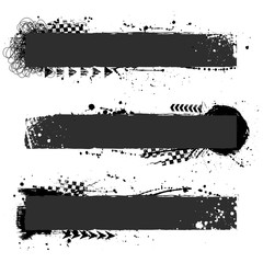Black grunge elements with tire tracks isolated on white background