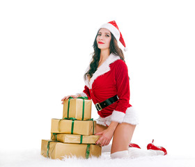 Beautiful young woman in Santa Claus looking at the camera clothes over Christmas isolated on white background. New year and Christmas celebration concept.