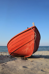 Red boat at seaside