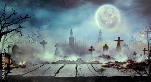 Halloween design with wooden table and graveyard