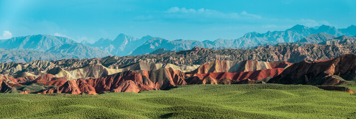 Wide panorama of Zhangye Danxia geological park in Gansu Province, China. Chinese landscape with geological layers.