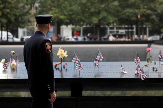 New York City Fire Department (FDNY) firefighter during ceremonies commemorating 18th anniversary of September 11, 2001 attacks at the 911 Memorial in New York