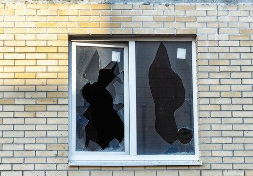 Broken window on an abandoned construction site after developer bankruptcy