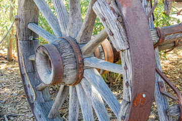Antique rustic wood and metal wagon wheel