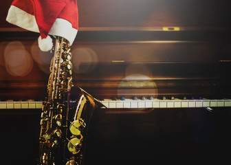 piano keys  and Saxophone with Santa clause hat in the night at home, Christmas music  background...