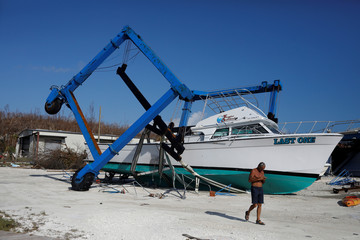 A destroyed crane and a boat are seen at a marina after Hurricane Dorian hit the Abaco Islands in Marsh Harbour