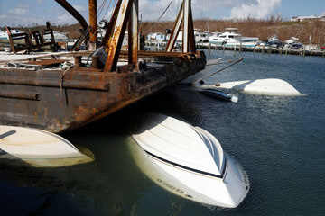 Capsized boats are seen at a marina after Hurricane Dorian hit the Abaco Islands in Marsh Harbour