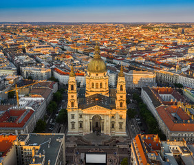 Budapest, Hungary - Aerial drone view of the beautiful St. Stephen's Basilica from high above at sunset with warm summer afternoon lights and clear blue sky