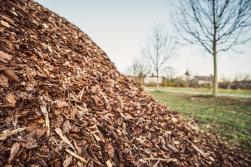 small stored hill of brown mulch and wood shavings