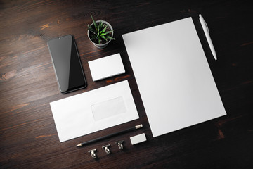 Photo of blank stationery set on wooden background. Corporate identity mockup. Responsive design template.