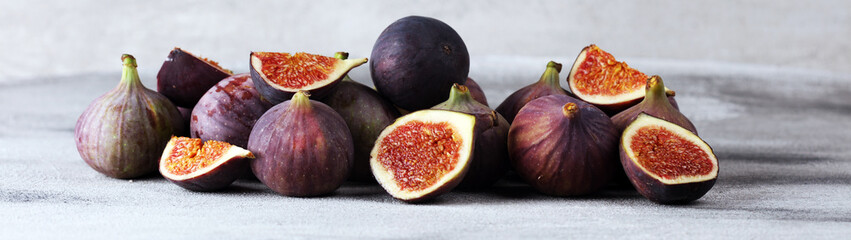 Fresh figs. Food Photo. whole and sliced figs on beautiful rustic background.