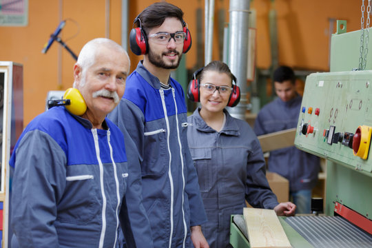 woodworking apprentice posing and smiling with teacher