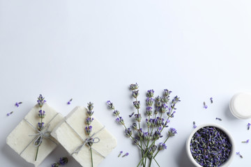 Wall Mural - Composition with hand made soap bars and lavender flowers on white background, top view