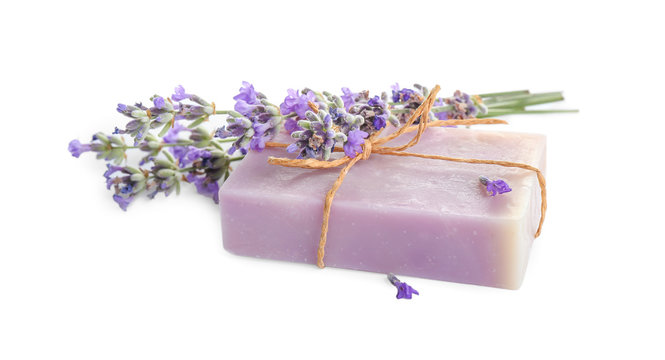 Hand made soap bar with lavender flowers on white background