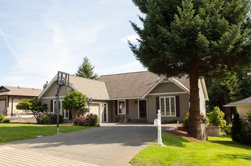 Suburban house with basketball hoop in driveway