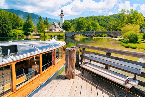 Terrific Touristic Boat And Wooden Bench Bohinj Lake In Slovenia Evergreenethics Interior Chair Design Evergreenethicsorg