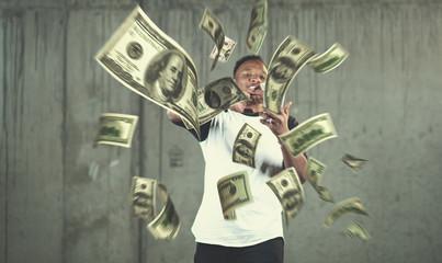 black businessman making the rain of money