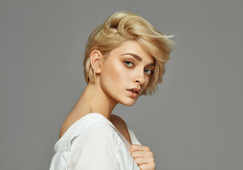 Portrait of young woman with blond short hair