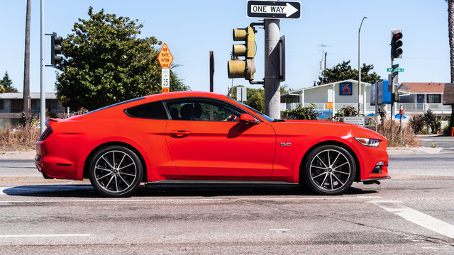 September 1, 2019 Sunnyvale / CA / USA - Orange colored Ford Mustang side view