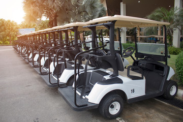 Electric golf cars parked in an orderly manner at the parking lot