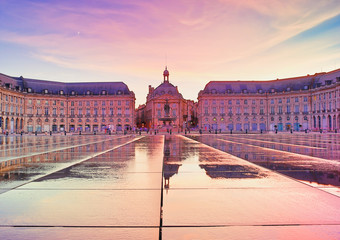 Colorful sunset at Place de la Bourse square in Bordeaux, France, one of the most visited and photographed sites in the Gironde Capital.