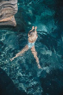 Overhead view of woman swimming in sea