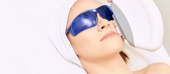 Laser facial hair removal. Cosmetology ipl device. Woman body in clinic. Medical beauty girl. Acne salon treatment tool