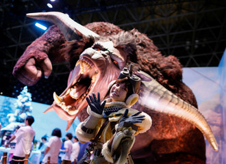 A model wearing costume poses for a photograph at Capcom booth at Tokyo Game Show 2019 in Chiba