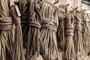 handcraft ship ropes hang on wooden wall