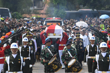 Indonesian soldiers carry the casket of former Indonesian President B.J. Habibie, who passed away yesterday, during a funeral ceremony of at Kalibata Heroes Cemetery complex in Jakarta