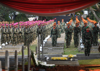 Indonesian soldiers take part in a funeral ceremony of former Indonesian President B.J. Habibie, who passed away yesterday, at Kalibata Heroes Cemetery complex in Jakarta