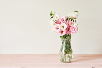 a bouquet of eustomas flowers on the table