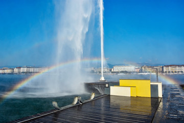 Jet d'Eau water fountain with rainbow, beautiful attraction and symbol of Geneva , Switzerland Wall mural