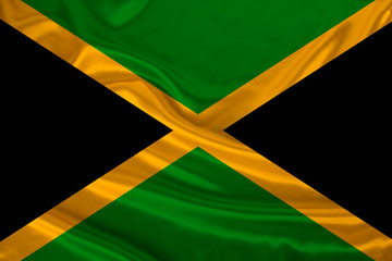 photo of the national flag of the state of Jamaica on a luxurious texture of satin, silk with waves, folds and highlights, close-up, copy space, illustration
