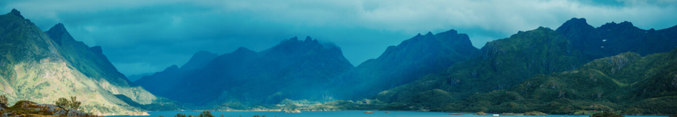 Spoed Foto op Canvas Groen blauw Panoramic photo of picturesque highlands, sea, cloudy sky in Norway
