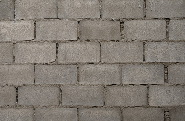 The block wall is a new finish wall, fence or house wall. Gray block background image