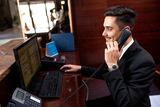 Elegantly dressed receptionist holding a headphone