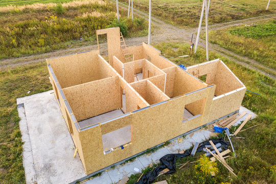 Construction of new and modern modular house. Walls made from composite wooden sip panels with styrofoam insulation inside. Building new frame of energy efficient home concept.