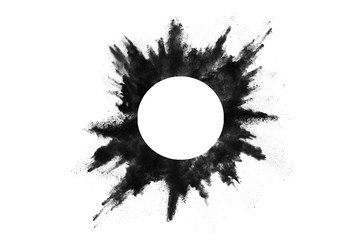 Particles of charcoal on white background,abstract powder splatted on white background,Freeze motion of black powder exploding or throwing black powder.