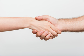 Man and woman shaking hands isolated over white wall background.
