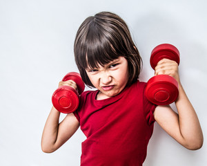 mad frowning child expressing rage and violence with bully dumbbells