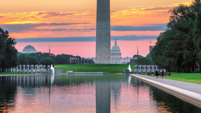 Washington Monument and US Capitol Building at sunrise, Washington, DC,  USA.