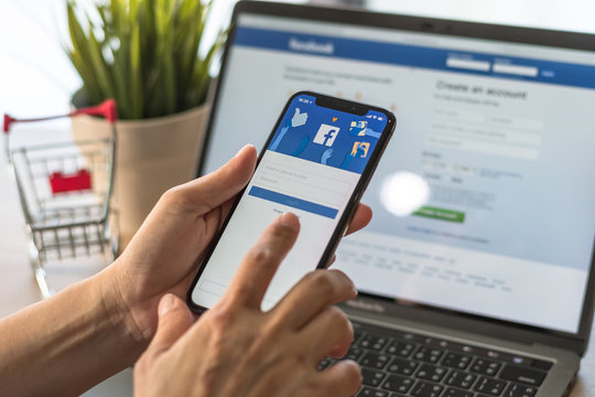 BANGKOK, THAILAND - May 2, 2018: Facebook social media app logo on log-in, sign-up registration page on mobile app screen on iPhone X (10) in person's hand working on e-commerce shopping business
