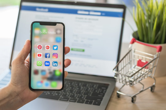 BANGKOK, THAILAND- March 21, 2017: Social media app multi-channel icons on iphone X touchscreen mobile computer cross-channel internet application technology for shopping lifestyle in digital 4.0 age